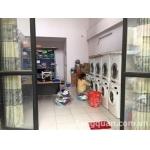 Cần sang tiệm giặt ủi gần Bến Xe Miền Đông, khu dân cư sầm uất.